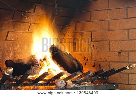 Close up view of a traditional warm fireplace.