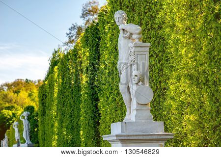 VIENNA, AUSTRIA - CIRCA APRIL 2016: Schonbrunn gardens with statues in Vienna. Schonbrunn palace is one of the most important architectural and historical places in Austria