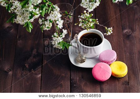 Cup Of Coffee And Blooming Twig Of Cherry Tree