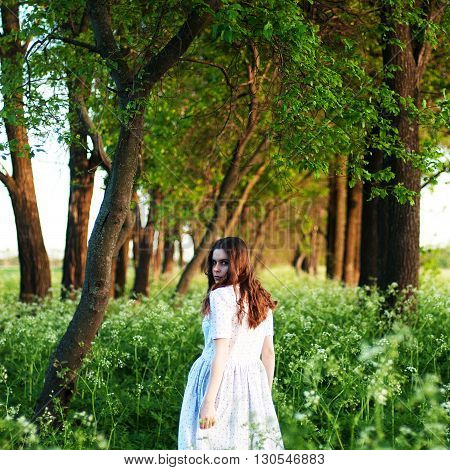 Pretty Young Woman In Long White Dress And With Long Golden Curl