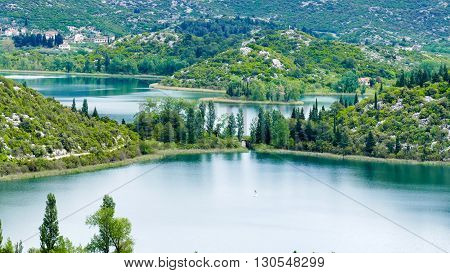 The lakes are part of a picturesque landscape and surrounded by mountains. They are situated between Makarska and Dubrovnik. It is a crypto-depression lake with its bottom below the surface of the sea.