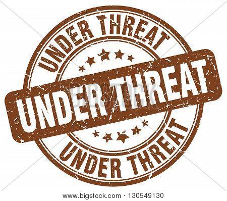 under threat brown grunge round vintage rubber stamp