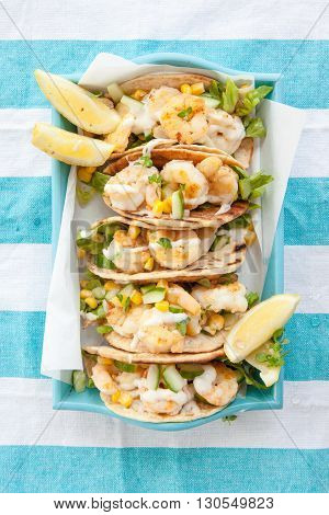Shrimp tacos with fresh lemon cucumber and corn