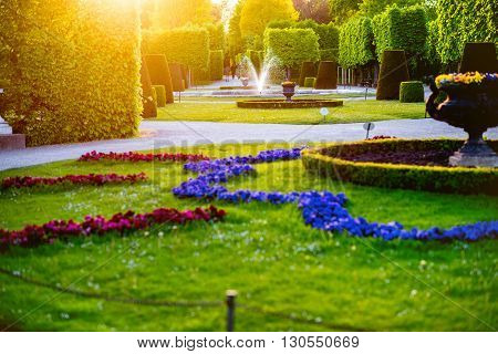 VIENNA, AUSTRIA - CIRCA APRIL 2016: Beautiful flower garden in Schonbrunn Palace in Vienna. Schonbrunn gardens are one of the most important architectural and historical places in Austria