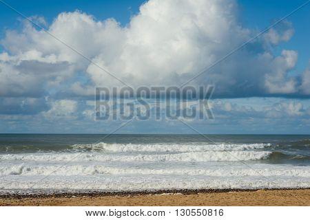 Blue sky with clouds and sandy beach near sIdI Ifni in Morocco.