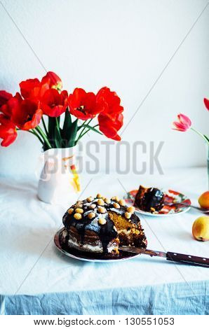 Piece of cake with Chocolate Glaze and raspberries on plate on white background. Beautiful composition with chocolate cake and raspberries. Cheesecake with raspberry and chocolate