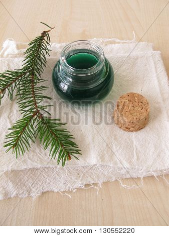 Spruce needle bathing oil in small bottle