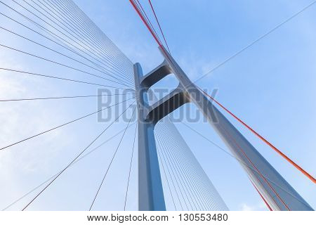 cable stayed bridge closeup against blue sky upward view