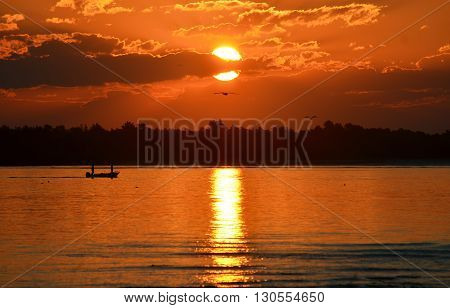Fishing boat on the bay at sunset