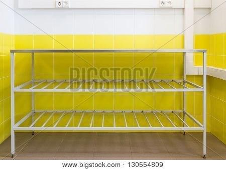 Metal Professional Cooking Table On Background Wall