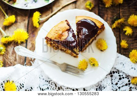 Traditional homemade chocolate cake. Rustic style and natural light. Chocolate Mud Cake on White table. Piece of chocolate cake with icing. Vanilla Cake with Chocolate Glaze.
