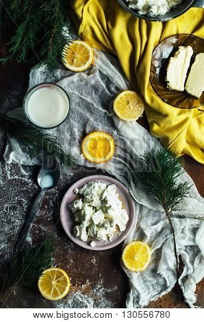 Healthy breakfast product concepts. Homemade cottage cheese.Healthy and diet food concept. Rustic style. Top view. Plate of homemade cottage cheese. Dark rustic atmosphere.