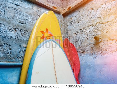 Paddles-boards With Oars Standing In Corner