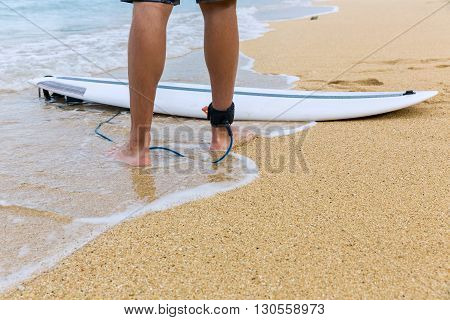 Surfer Standing On Sand Near The Ocean