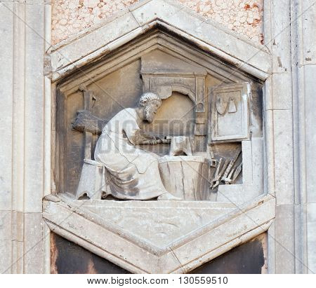 FLORENCE, ITALY - JUNE 05: Tubalcain by Nino Pisano, 1334-36., Relief on Giotto Campanile of Cattedrale di Santa Maria del Fiore (Cathedral of Saint Mary of the Flower), Florence on June 05, 2015
