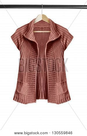Brown knitted jacket on clothes rack isolated over white