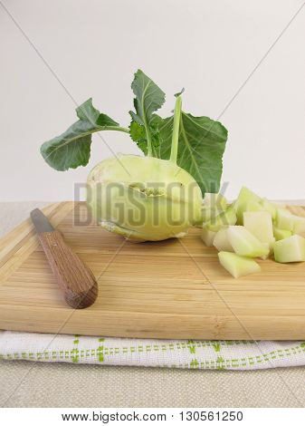 German turnip ready to cook on wooden board