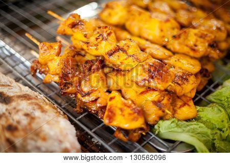 Fresh made chicken satay skewer. Traditional thai cuisine on market.