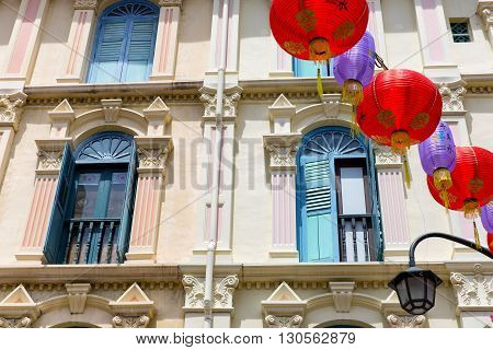 Chinese lanterns in front of colorfull building