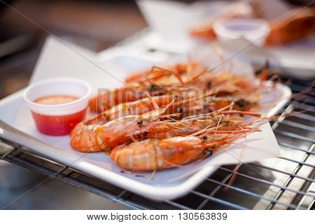 Fresh fried prawns in shells served with sweet chilli sauce. Traditional thai cuisine.