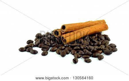 Several sticks of cinnamon and coffee beans. / Isolated on white background / close-up.