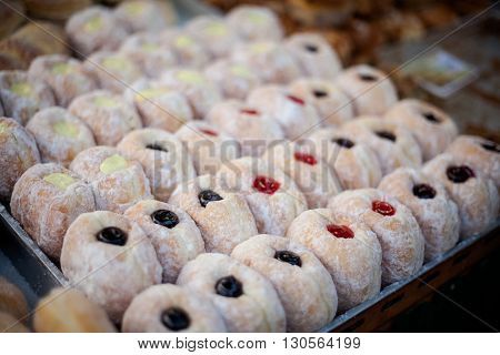Fresh made donuts Pa Thong Ko stuffed with colofrul filling. Traditional thai dessert.