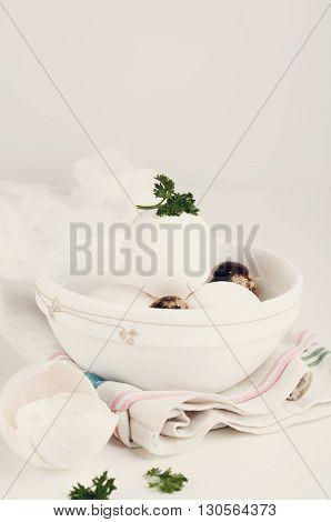 Eggs in white bowl a healthy food for gift  on white backgraund .Toned photo