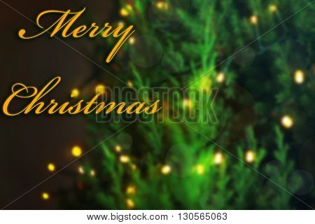 Illuminated Christmas tree on wall background
