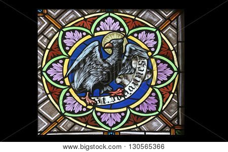 OBERSTAUFEN, GERMANY - OCTOBER 20: Symbols of the Saint John the Evangelist, stained glass window in the parish church of St. Peter and Paul in Oberstaufen, Germany on October 20, 2014.