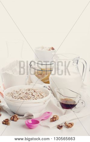 Oatmeal porridge with glass of milk on wooden table,  .Toned photo