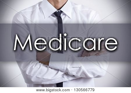 Medicare - Young Businessman With Text - Business Concept