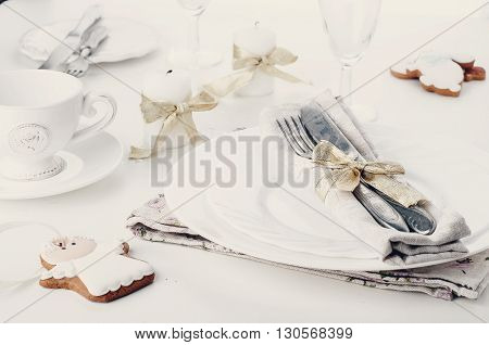 Christmas place setting with christmas cookies and candles .Toned photo