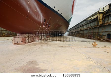 Front view of large cruise ship at dry dock