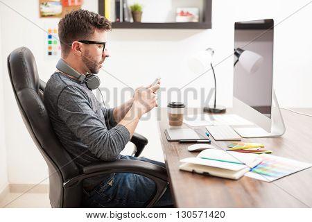 Graphic Designer Using A Smartphone