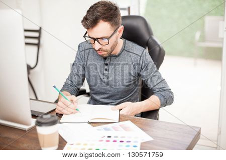 Designer Drawing A Sketch At The Office