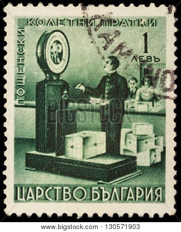 MOSCOW RUSSIA - MAY 20 2016: A stamp printed in Bulgaria shows weighing parcels at the old post office circa 1940