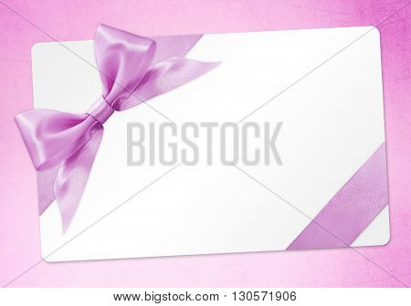 gift card with pink ribbon bow Isolated on pink background