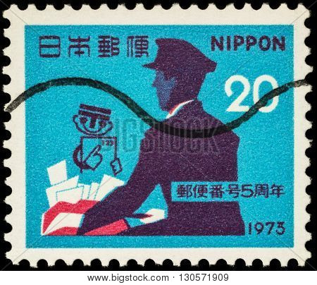 MOSCOW RUSSIA - MAY 20 2016: A stamp printed in Japan shows Postman with letters and post symbol series
