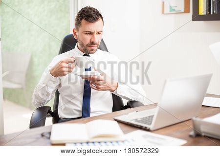 Businessman Drinking Coffee At The Office