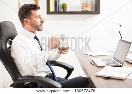 Young Lawyer Drinking Coffee In His Office