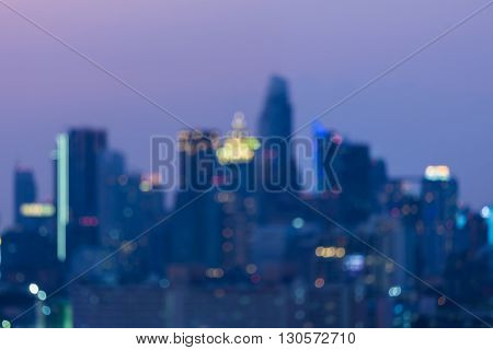Night blurred lights, city office tower, abstract background