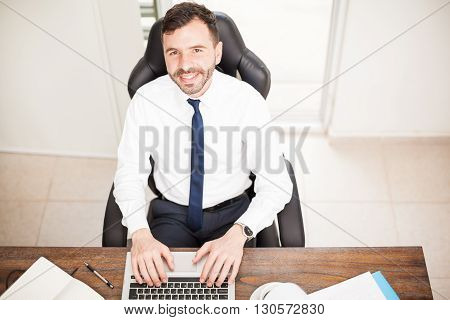 Happy Businessman Working In An Office
