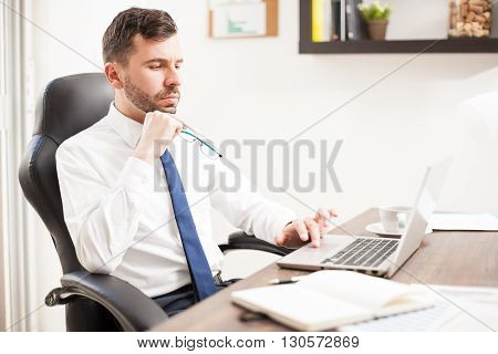 Thoughtful Businessman Working In An Office