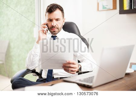 Attorney Reviewing Documents Over The Phone