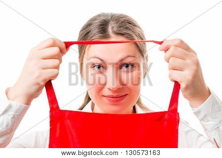 Young Brunette Wears A Red Apron Isolated