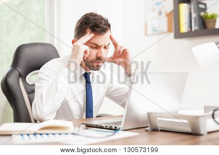 Businessman With A Headache In An Office