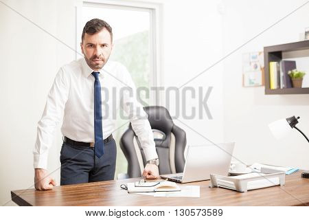 Confident Businessman In His Office
