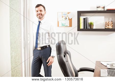 Latin Businessman Relaxing In His Office