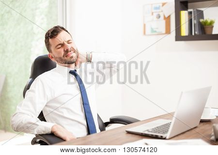Lawyer Dealing With Neck Pain In An Office