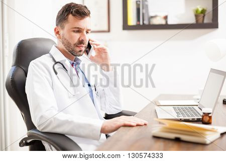 Pediatrician Talking On The Phone In An Office